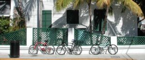 Key West neighborhood with bikes leaning up against a fence